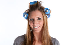 Smiling Housewife. Friendly Housewife With Rolls In Her Hair Royalty Free Stock Photography
