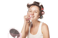 Smiling housewife with curlers Royalty Free Stock Photo