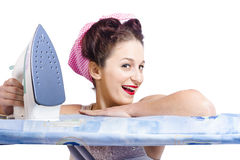 Smiling housewife doing housework laundry duties Stock Photography