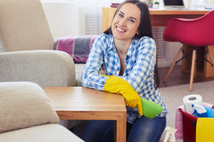 Smiling housewife having rest after cleaning of table Stock Photography