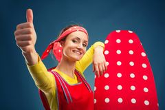 Smiling housewife with ironing-board Royalty Free Stock Image