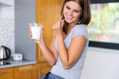 Smiling housewife relaxing in kitchen. Smiling housewife relaxing in modern kitchen Royalty Free Stock Image
