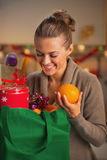Smiling housewife sorting purchasing after christmas shopping Royalty Free Stock Photos