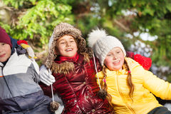 Smiling and hugging children in winter at forest Stock Images