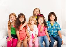 Smiling and hugging kids Royalty Free Stock Photos