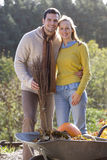 Smiling husband and wife doing yardwork together Royalty Free Stock Images