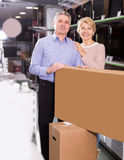 Smiling husband and wife purchased and packed appliances Royalty Free Stock Image