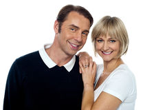 Smiling husband and wife striking a romantic pose Royalty Free Stock Image