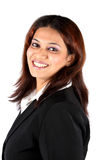 Smiling Indian Businesswoman. A portrait of a smiling young Indian businesswoman, on a white background Stock Photography