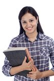 Smiling Indian female student against white Stock Image