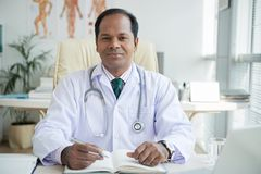 Smiling Indian general practitioner royalty free stock photography