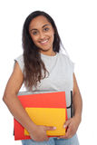 Smiling Indian Girl Carrying Books and Documents. Close up Portrait of a Smiling Indian Girl in Casual Outfit Carrying Books and Documents While Looking at the Royalty Free Stock Images