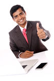 Smiling Indian professional showing thumbs up Stock Images