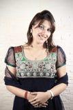 Smiling indian punjabi girl. In traditional dress looking beautiful Royalty Free Stock Images