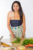 Smiling Indian Woman Cutting Herbs Royalty Free Stock Photos