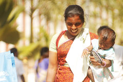 Smiling indian woman with her child Stock Photography