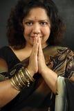 Smiling Indian woman praying stock photo