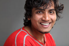 Smiling Indian young man Stock Image