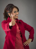 Smiling Indian young Woman showing thumb up sign isolated on white background Royalty Free Stock Image