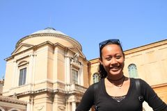 Smiling girl in Vatican Museum Stock Photography