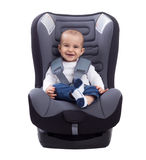 Smiling infant baby boy sitting in a car seat, isolated on white Royalty Free Stock Image