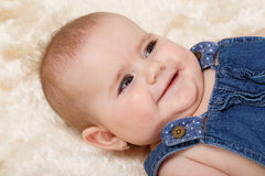 Smiling infant baby. The first year of the new life Royalty Free Stock Photo
