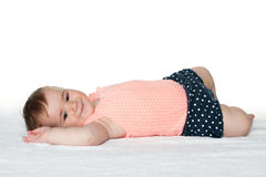 Smiling infant girl on the white towel Stock Photo