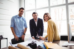 Smiling interior designer with coworker Royalty Free Stock Photos