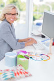 Smiling interior designer working on her computer Royalty Free Stock Image