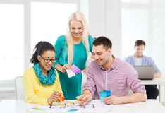 Smiling interior designers working in office Stock Photos