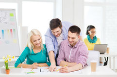 Smiling interior designers working in office Royalty Free Stock Photography