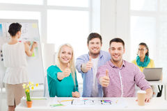 Smiling interior designers working in office Stock Photography