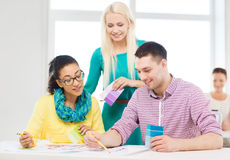 Smiling interior designers working in office Stock Photo