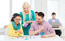 Smiling interior designers working in office Royalty Free Stock Image