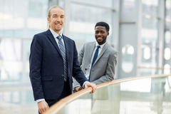 Smiling International Business partners in Office Building Stock Images