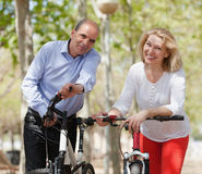 Smiling international family with bikes Stock Images