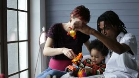 Smiling interracial family enjoying time together stock footage