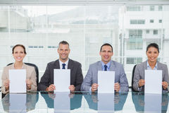 Smiling interview panel holding white paper Stock Photography