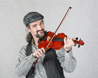 Smiling Irish Fiddler Performing Royalty Free Stock Images