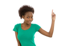 Smiling isolated afro american girl raising up her finger. Royalty Free Stock Images
