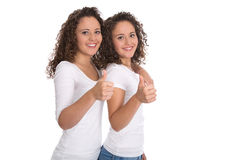 Smiling isolated girls with thumbs up: real twins. Stock Image