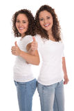 Smiling isolated girls with thumbs up: real twins. Royalty Free Stock Photo