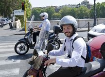 Smiling Italian man on the scooter