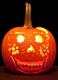 Smiling Jack O' Lantern with Candle Lit. Royalty Free Stock Images