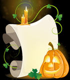 Smiling Jack o Lantern, parchment and burning cand Royalty Free Stock Photos