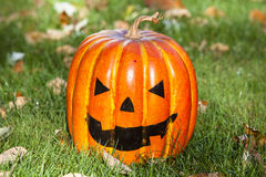 Smiling jack-o-lantern. A smiling pumpkin sits ready to greet Halloween trick or treaters Stock Image