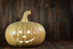 Smiling Jack-o'-lantern on Wood Stock Photos