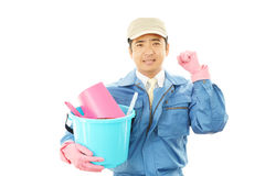 Smiling janitor Stock Images
