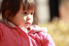 Smiling Japanese baby girl under the blue sky Stock Images