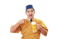 Smiling Japanese chef with beer Royalty Free Stock Photo